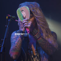 Lexxi Foxx of Steel Panther primps during a concert